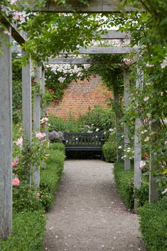 10 Ways English Gardens Borrow from France A rustic pergola decorated with roses and boxwood.A rustic pergola decorated with roses and boxwood. Diy Pergola, Rustic Pergola, Pergola Swing, Cheap Pergola, Wooden Pergola, Backyard Pergola, Pergola Shade, Pergola Plans, Gazebo