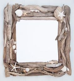 During these past few hot evenings I have been hard at work making a pair of driftwood and sea shell mirrors. The driftwood was found on a beach in West Wales - lovingly selected and pieced together, along with some lovely sea shells and star fish. T