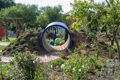 The kids ride their bikes through the tunnel and screech in delight at the experience of being closed in through this little experience. Kids Tunnel, Herb Farm, Natural Playground, Play Yard, Kids Ride On, Farm House, Herbs, Outdoors, Nature