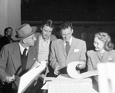 Frank Sinatra, Jimmy Durante, Peter Lawford, and Jane Powell rehearse for a Songs by Sinatra broadcast, February 1947
