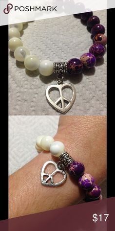 """HP 2/22 Purple Jasper Pearl Heart Bracelet This lovely bracelet is made with mother of pearl and purple sea sediment jasper. The heart shaped peace sign adds a unique touch. This piece measures 8"""" in circumference and is elastic. All PeaceFrog jewelry items are made by me! Take a look through my boutique for coordinating jewelry and more unique creations. PeaceFrog Jewelry Bracelets"""