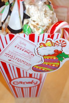 """inexpensive but fun Christmas gift for neighbors and such...  """"thanks for letting us pop in""""  **white chocolate drizzled over kettle corn and topped with mint M&Ms**"""