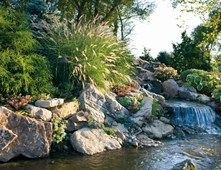 Natural Backyard Rock Waterfall Pond and Waterfall Small's Landscaping Inc Valparaiso, IN