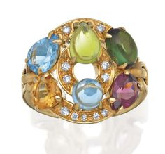 DIAMOND AND GEM SET 'ASTRALE' RING, BULGARI   Centring on a curved shield pavé set with round brilliant cut diamonds and variously cut multi coloured gemstones to an articulated band, mounted in 18ct gold, signed BVLGARI.
