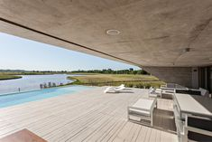 Situated on the edge of the Paraná river delta in Argentina, the N House appears as a monolithic mass floating on the landscape. The concrete. Protecting Your Home, Security Cameras For Home, Winter Photos, Space Gallery, Water Damage, Home Security Systems, Interior Architecture, Interior Design, Ground Floor