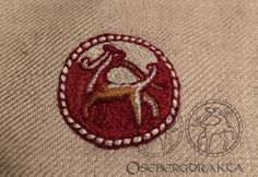 Oseberg textile Embroidery 12 B1 5.6x3cm The animals are placed back to back, with the heads facing each other Silk thread embroidery The frames were sewn with a bead-like seam Colors likely: Red-brown, brown, bronze and red This kind of naturalistic representation of animals in embroidery does not occur in Nordic art at this time The S-shaped volutes appear extensively in Irish and Anglo-Saxon manuscripts The motif with an animal figure in a circular beaded medallion is of oriental origin Nordic Art, Anglo Saxon, Brown Brown, Silk Thread, Vikings, Irish, Oriental, Frames, Bronze