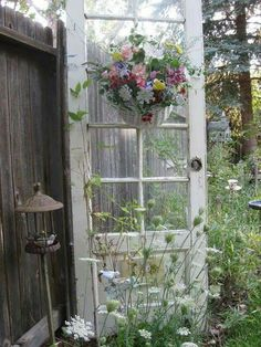 This is all so pretty...the teacup bird feeders...flowers on the door