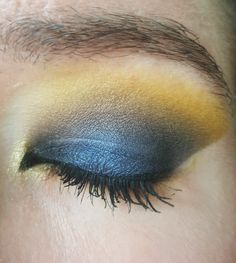 Urban Decay Basquiat Gold Griot palette using the blackened blue on the lid, grey in the crease,  a NYX yellow matte transition,  covered with shimmery gold from UD, also UD Evidence on the center of the lid