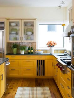 Yellow cabinets with slots to put your large, flat baking items