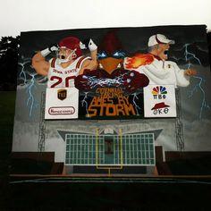 Homecoming banner of Jake Knott and Paul Rhoads. #Cyfanweek @Iowa State Athletics