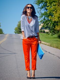 striped top with orange pants More