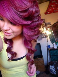 magenta hair, I like the color and the curls but the cut and the style looks stupid.