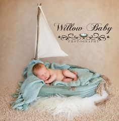 Newborn sailing photo newborn baby in boat www.willowbabyphotography.com