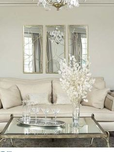 3 mirrors above couch. … | Home