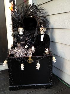 Had an old chest ..I sprayed it black..opened it up..spray painted an old fall wreath black and hung on chest...put a black board across open part for my skeletons to sit on.