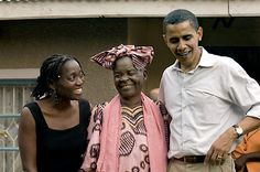 Sen. Barack Obama talks to the press while standing with his sister, Auma Obama, and his grandmother, Sarah Hussein Obama, outside her house in his family's village of Kogelo, Kenya. August 26, 2006