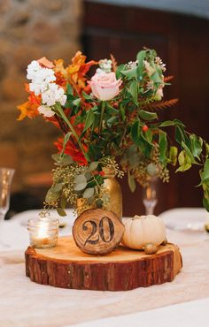 perfect rustic centerpiece, photo by @Daniel Cruz styling by @Collette Budd http://ruffledblog.com/romantic-lake-gregory-wedding #centerpieces #rustic #weddingideas
