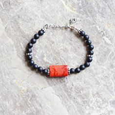 Matt Black Onyx bracelet with coral  pendant by CharmByIA on Etsy, $35.00