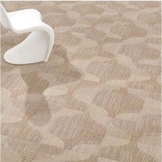 Tufted, textured cut pile carpet made by Milliken.  Cushion-back carpet tile. Collection: Under the Sea, Design: Silhouette, Color: Sand.