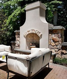 Outdoor fireplace kits makes installation easy for contractors outdoor fireplace with stucco and stone arch solutioingenieria Choice Image