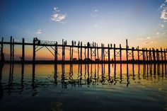 U Bein Bridge, stretching some 1.2km, is the longest teak bridge in the world, crossing a lake to link two suburban areas of Mandalay.