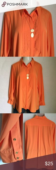 ✨NEW Listing✨Vince Camuto pleated plus blouse Vince Camuto button-front orange plus-size top with a pleated tuxedo bib. Goldtone logo buttons on the sleeves and covered button placket down front. Pleated back with yoke. Size is 2X. 100% polyester. Not interested in trades. Vince Camuto Tops Blouses