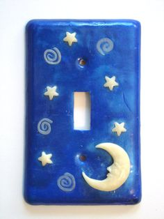 Switchplate with glow-in-the-dark stars and moon