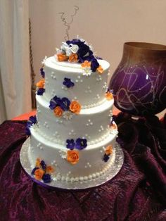 3tier Butter icing wedding cake with Orange and purple gum paste flowers