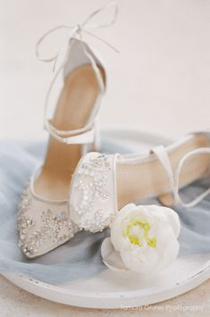 Florence 'Enchanted' bridal collection. Hand beaded ivory wedding heels with milky teardrop stones, beads and cross ankle straps. Designer wedding shoes. Shop now! #weddingshoes