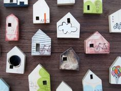 Ceramic houses. Like the little windows and open back. Would be interesting to mount on patterned paper to peer at through the window.