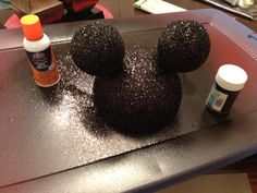 Spray paint. Let dry. Spray glue add glitter. Then bow