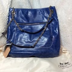 "NWT COACH POPPY LEATHER SLIM TOTE. NWT Coach Poppy Leather Slim Tote. Cobalt blue. 14 1/4"" (L) x 12 3/4"" (H) x 2 1/4"" (W) Double straps with 9 1/2"" drop convert to single long strap for crossbody wear, Outside pocket Snap closure, fabric lining, Inside zip, cell phone and multifunction pockets, dust bag Coach Bags Totes"