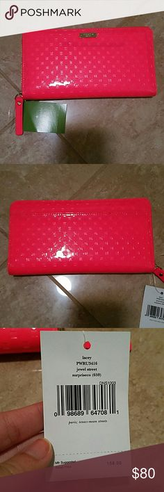 NWT Kade Spade wallet New with tag Kate Spade wallet in the style lacey and pattern jewel street. The color is surpriseco which is a bright, neon pink/coral color. Has multiple card slots as well as a zipperred coin purse. Because of the jelly material, you can see a black mark underneath. kate spade Bags Wallets