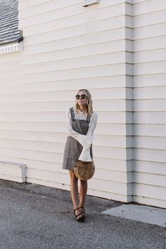 """It's been an on again off again fall that's happening recently in Los Angeles and I'm not entirely hating it. It's very """"LA"""" to wear a sweater with a skirt so I figured why not throw one on under a dress too. See by Chloe Top {$260} // Sezane Dress {$140} // Cult Gaia Clutch … read on"""