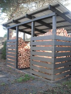 Woodshed for winter wood. Put shelf in the middle of each stack so you can access the older wood yet load the new on top.
