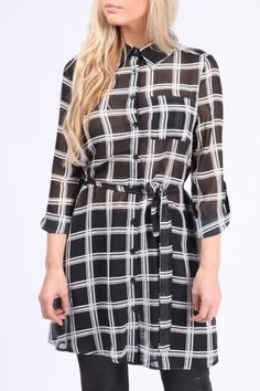 Shirt Dress Black Price: € 39.00  Grid check print on chiffon fabric, soft pleat at the back, removable belt tie, turned up sleeves, pointed collar, button front fastening, front welt pocket