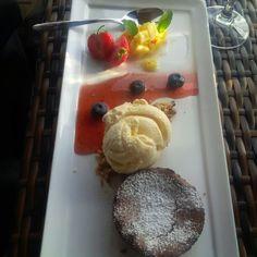Chocolade pudding with vanilla ice cream and ananas on strawberry juice