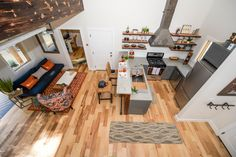 A modern and rustic home, designed and built by Wind River Tiny Homes. Spanning just 600 sq ft, the home has everything from a full kitchen to an outdoor porch.