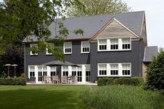 Dark grey walls, white window and wood