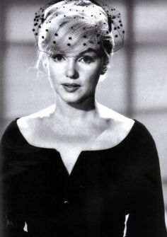 A particularly striking Marilyn Monroe, most beautiful without the jewels, garnish colours and heavy make-up.