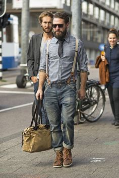 Shop this look on Lookastic:  https://lookastic.com/men/looks/long-sleeve-shirt-jeans-boots-tote-bag-tie-sunglasses-suspenders/13175  — Dark Brown Sunglasses  — Charcoal Tie  — Beige Suspenders  — Navy Jeans  — Tan Canvas Tote Bag  — Brown Leather Boots  — Grey Vertical Striped Chambray Long Sleeve Shirt