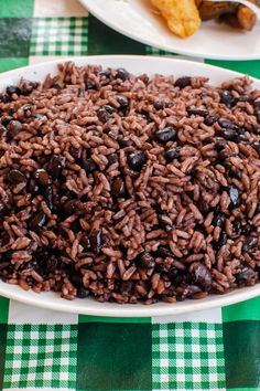 Try this easy and delicious authentic Cuban rice and beans recipe for a taste of Cuba in your home. This classic dish is served everywhere you go in Cuba and goes with just about anything.  #cubanrice #blackbeans #beansandrice