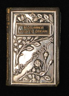 Edwardian, novelty silver-covered miniature book 'Midsummer Night's Dream' by William Shakespeare. The cover is hallmarked by Levi & Salaman for Birmingham 1904. The book was published by David Bryce and Son, Glasgow & Frederick A. Stokes Company, New York.