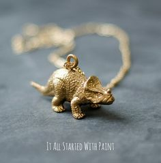 Make tiny plastic animals extra ~charming~ by coating them with gold paint and attaching a pendant loop.
