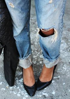 Ripped boyfriend jeans with pointy-toed flats. Classic love.