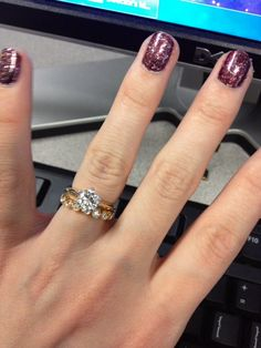 I really like the Tiffany solitaire with a bezel wedding band and I am completely obsessed with yellow gold! (: