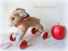 Steiff pull toy rabbit, firmly stuffed hopping mohair bunny on eccentric wooden wheels, made in Germany 1950 – 64 with Steiff button + label by ShabbyGoesLucky on Etsy https://www.etsy.com/listing/258085638/steiff-pull-toy-rabbit-firmly-stuffed
