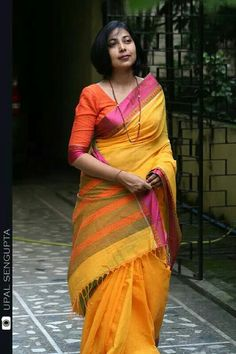 Dhonkaili handloom cottom saree with fuschia satin border..orange blose with yellow saree..nice contrast