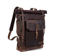 A unique and beautiful style rolltop leather backpack. Made from high quality leather. The length of the straps allow to hold a jacket or pullover with the bag. External pocket can be used to hold a tablet upto 10 inches. Internally there a zipper pocket and a laptop sleeve. Size of the bag is fully customizable.