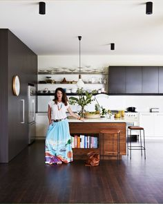 Rebecca Udvary's modern kitchen with open shelves and pendant light